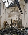 interieur, overzicht met restanten van muurschilderingen, na de brand - tilburg - 20345210 - rce