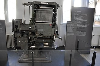 "Phototypesetting - An Intertype Fotosetter, one of the most popular ""first-generation"" mass-market phototypesetting machines. The system is heavily based on hot metal typesetting technology, with the metal casting machinery replaced with photographic film, a light system and glass pictures of characters."