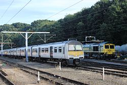 Ipswich - Greater Anglia 321330 and Freightliner 66956.jpg