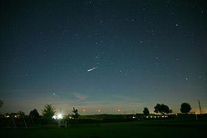 Magnitude (astronomy) - Night sky with a very bright satellite flare