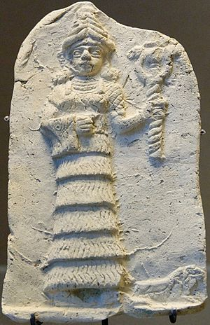 Ishtar - Old Babylonian relief from the early second millennium BCE showing Ishtar wearing a crown and flounced skirt, holding her symbol, currently held in the Louvre Museum