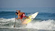 Surfeur sur un paddle