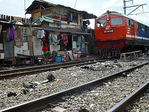 Slum shelters built by train tracks in Jakarta