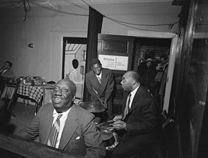James P. Johnson - James P. Johnson, Fess Williams, Freddie Moore, Joe Thomas 1948.  Photography by William P. Gottlieb.