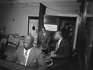 James P. Johnson - James P. Johnson, Fess Williams, Freddie Moore, Joe Thomas 1948.  Photography by William P. Gottlieb.