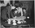 Jedburghs get instructions from Briefing Officer in London flat. England, circa 1944. - NARA - 540064.tif