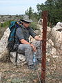 Jim and some barbed wire fence (3091456423).jpg