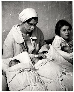 Strategic bombing during World War II - Polish mothers with their newborn infants in a makeshift maternity ward inside a hospital basement during the Bombing of Warsaw by the German Luftwaffe.