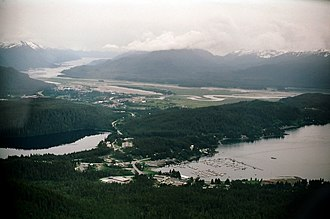 Auke Bay, Juneau - Aerial view shows Auke Bay (including the harbor and Auke Lake) in the foreground.  The Mendenhall Peninsula extends to the right behind the community.  The lower Mendenhall Valley, Juneau International Airport and Douglas Island are in the background.