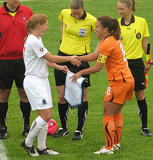Kacey White - White exchanges crests with Lori Chalupny of the St. Louis Athletica, 2010.