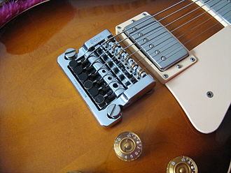 "Bridge (instrument) - A licensed Kahler vibrato system on a '87 Gibson Les Paul Standard. Note that the ""whammy bar"" lever is not attached in this photo."
