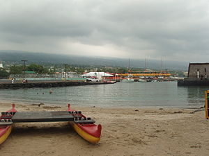 Kamakahonu - The small beach is protected by the pier