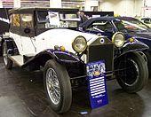 https://upload.wikimedia.org/wikipedia/commons/thumb/c/ca/Lancia_Lambda_white_vr_TCE.jpg/170px-Lancia_Lambda_white_vr_TCE.jpg