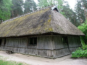 Post in ground - Some researchers consider sills placed on the ground, rather than on a foundation, to fall under the type earthfast construction. Fishing house without a chimney, circa 1750. Latvian Ethnographic Open Air Museum