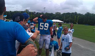 Luke Kuechly - Kuechly signing autographs at Panthers training camp.