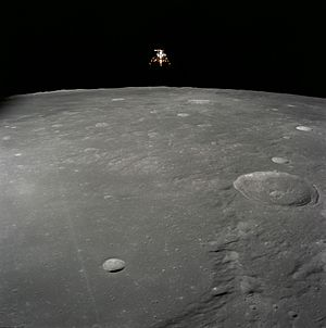 Exploration of the Moon - Apollo 12 lunar module Intrepid prepares to descend towards the surface of the Moon. NASA photo.
