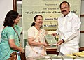 M. Venkaiah Naidu presenting the 100 Volume of 'The Collected Works of Mahatma Gandhi', published by the Publication Division, to the Speaker, Lok Sabha, Smt. Sumitra Mahajan for Parliament Library, in New Delhi.jpg
