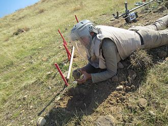 VS-50 mine - A deminer from non-governmental organisation MAG (Mines Advisory Group) disarms a VS-50 landmine in Dohuk governorate, Kurdistan Region of Iraq