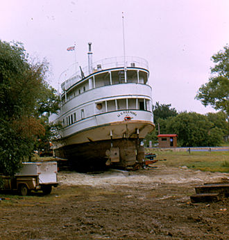 """Marine Museum of Manitoba - the """"last run"""" of the MS Keenora, being dragged into position at Selkirk Park, 1973"""