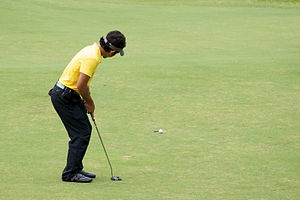 English: A Malay man playing golf at Colmar Tr...