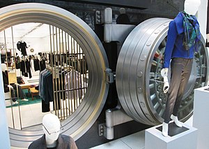 Manufacturers Trust Company Building - The bank vault door and vault opening is now the backdrop for a clothing display