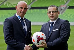 Kevin Muscat - Kevin Muscat alongside Melbourne Victory chairman Anthony Di Pietro at the Melbourne Rectangular Stadium in October 2013.
