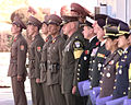 Members of the Joint Security Council stand at attention at the Military Demarcation Line waiting for members of the Korean People's Army to repatriate the remains of nine United Nations service members for 981106-F-DU876-512.jpg