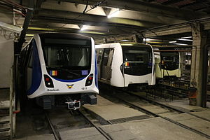 Bucharest Metro Line M2 - A CAF train on the left alongside two Movia trains on the right.