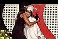 Michelle Obama hugs a graduate after giving her a diploma, 2011 (2).jpg