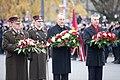 Ministru prezidents Valdis Dombrovskis vēro Rīgas garnizona vienību militāro parādi pie Brīvības pieminekļa (8174975569).jpg