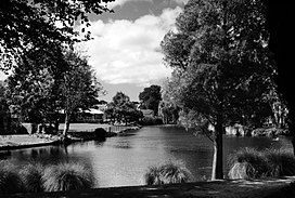 B&w photo of a waterway in a park setting
