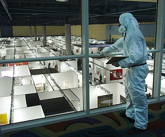 Johannes Grenzfurthner - Grenzfurthner acting as a CDC official at a staged virus outbreak at Art Basel Miami Beach 2005.