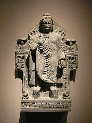 Abhijñā - The Buddha demonstrating control over the fire and water elements. Gandhara, 3rd century CE
