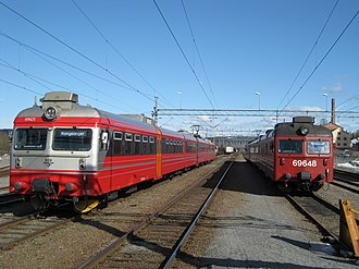 Oslo Commuter Rail - Two Class 69 units at Kongsvinger Station; new livery to the left, old livery to the right