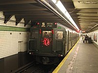 """The """"2007 Holiday Shopper's Special"""", December Sundays, a train of R1, R4, R7A, and R9 subway cars running in special service at the 23 Street (6 Avenue) station), R1 #100 at the end of this train as (V) service between Lower East Side-2nd Av & Queens Plaza only."""
