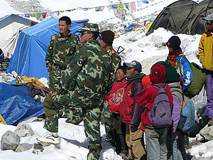 Some of the captured survivors with Chinese border guards at advance base camp Cho Oyu
