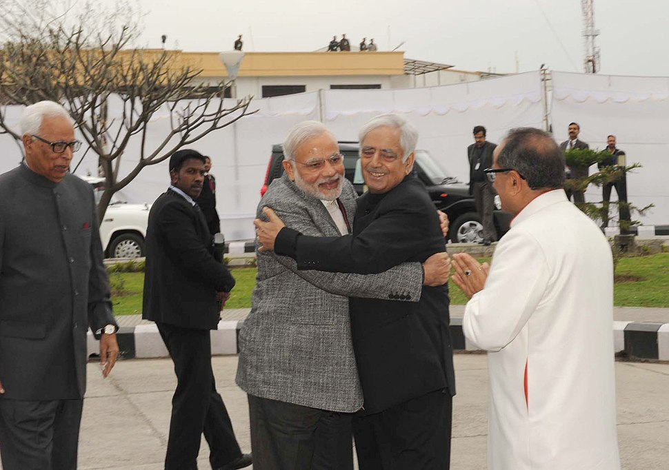 Narendra Modi arrives at the swearing-in ceremony of Mufti Mohammad Sayeed as Jammu and Kashmir Chief Minister, at Jammu University, in Jammu and Kashmir. The Governor of Jammu and Kashmir, Shri N.N. Vohra is also seen