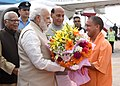 Narendra Modi being received by the Governor of Uttar Pradesh, Shri Ram Naik, the Union Home Minister, Shri Rajnath Singh and the Uttar Pradesh Chief Minister designate Yogi Adityanath, on his arrival, at Lucknow.jpg