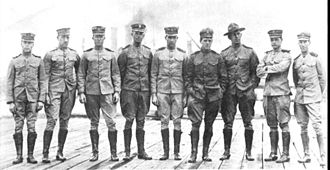 Henry C. Mustin (1874–1923) - The detachment of naval officers who established the Naval Aeronautic Station at Pensacola, Florida. Henry Mustin is fourth from right.