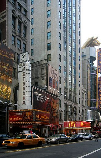 The Lion King (musical) - The Lion King on Broadway showing originally at the New Amsterdam Theater (shown); it is now showing at the Minskoff.