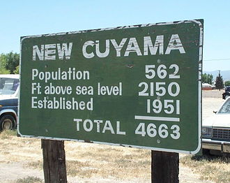 Mathematical joke - Humorously inappropriate use of numbers on a sign in New Cuyama, California.