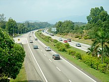 A dual highway with greenery on either side
