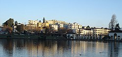 A view towards the Grand Avenue side of Lake Merritt. The apartments in view are part of the Adams Point neighborhood and are typical of the dense housing found in the area.