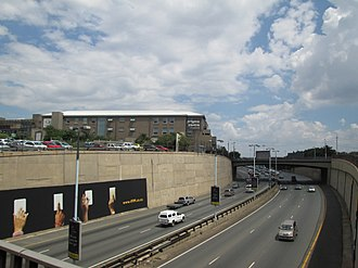 The Origins Centre museum at the University of the Witwatersrand viewed from across the M1 Origins Centre and M1 highway.jpg