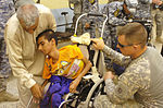 Paratroopers, National Police distribute wheelchairs in 9 Nissan DVIDS181364.jpg