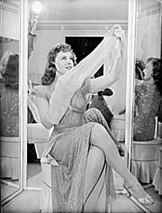 Goddard modeling cotton stockings during World War II, when nylon was widely unavailable.