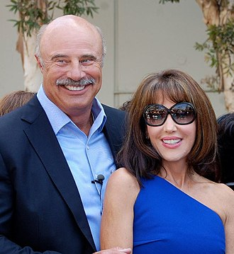 Phil McGraw - McGraw with wife Robin in May 2013