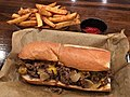 Philly cheesesteak with french fries.jpg