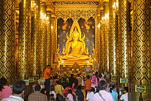 gilded statue of Buddha in Wat Phra Si Rattana Mahathat, Thailand