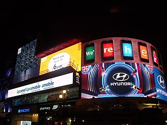 Advertising media selection - Piccadilly Circus, London is lit up with multiple out-of-home messages)